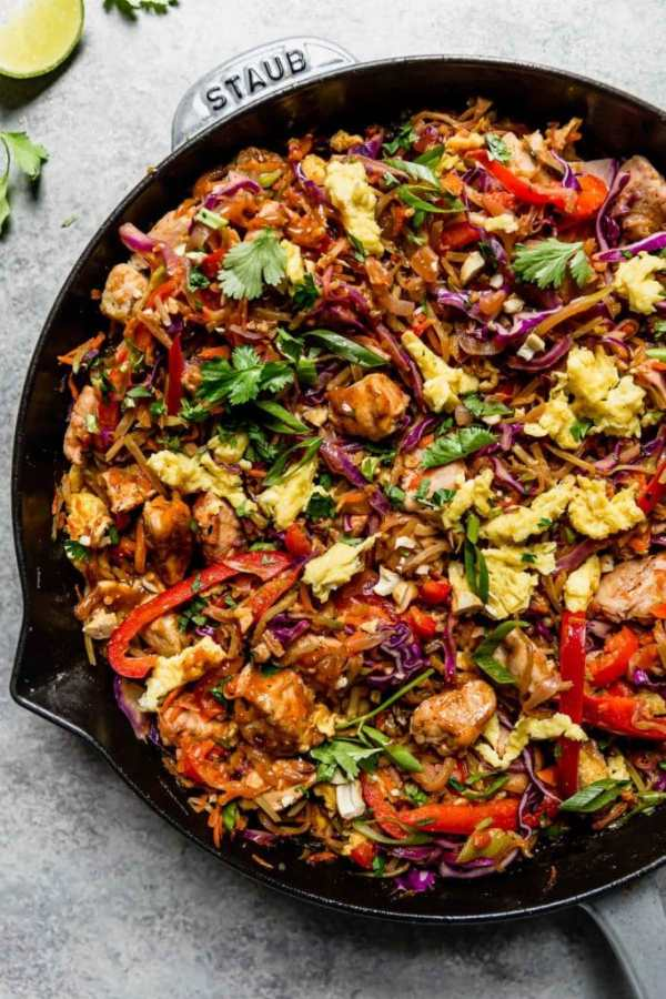 Healthy Chicken Pad Thai in a large cast iron skillet ready to serve.