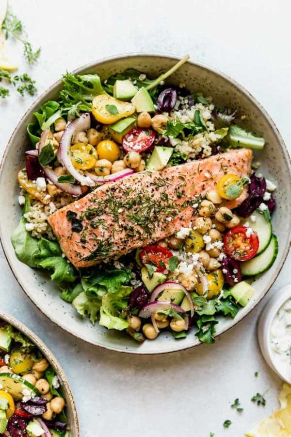 Mediterranean Bowl with Salmon in a light colored bowl.
