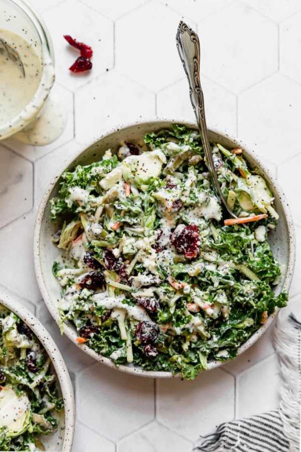 Sweet Kale Salad in a white speckled bowl.