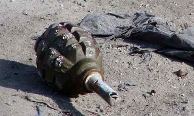 Terrorist hurled a grenade towards security forces near SBI Bank in main town Sopore
