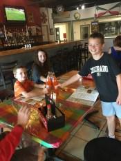 Adam, Gillian, and Karl enjoying Orange Fanta