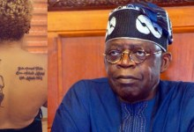 Photo of Woman tattoos Tinubu's face, birthday on her back