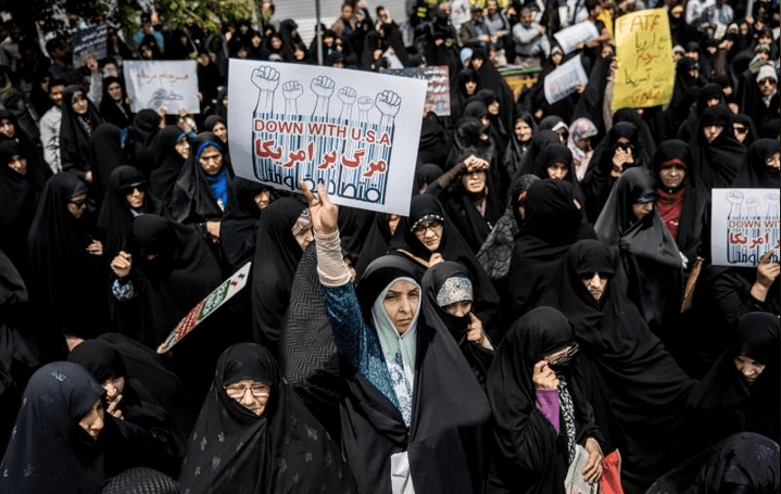 Iranian women protest in Tehran against U.S. President Donald Trump's decision to walk out of the 2015 nuclear deal, May 11, 2018. REUTERS/Tasnim News Agency
