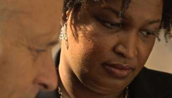 Stacey Abrams, Greg Palast review Georgia Purge list 2014 – Photo by Zach D Roberts