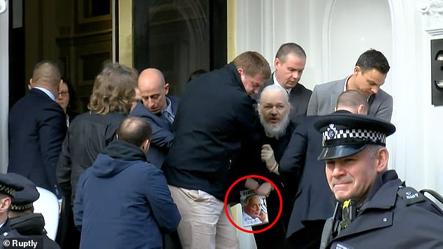 REVEALED: Julian Assange was carrying a book by Gore Vidal which criticizes the American military-industrial complex when he was dragged from the Ecuadorian embassy