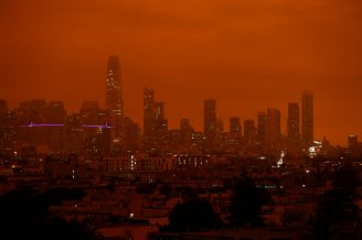 Downtown San Francisco is seen from Dolores Park under an orange sky darkened by smoke from California wildfires in San Francisco, California, U.S. September 9, 2020. REUTERS/Stephen Lam
