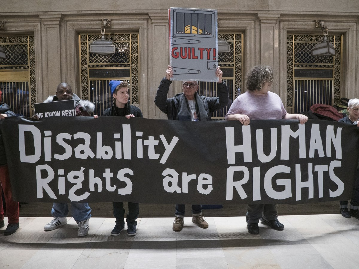 "Protesters with banner reading ""Disability Rights are Human Rights"""