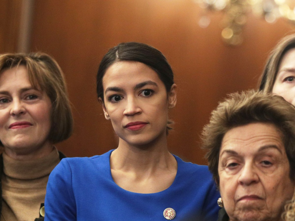 Rep. Kathy Castor (D-FL), Rep. Alexandria Ocasio-Cortez (D-NY), and Rep. Donna Shalala (D-FL) listen as Speaker of the House Rep. Nancy Pelosi (D-CA) speaks