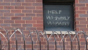 Sign pleading for help in Cook County jail window