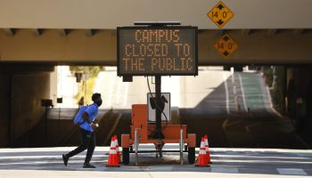Sign on Strathmore Place at Charles E Young Drive West entering the UCLA campus exclaims the campus is closed