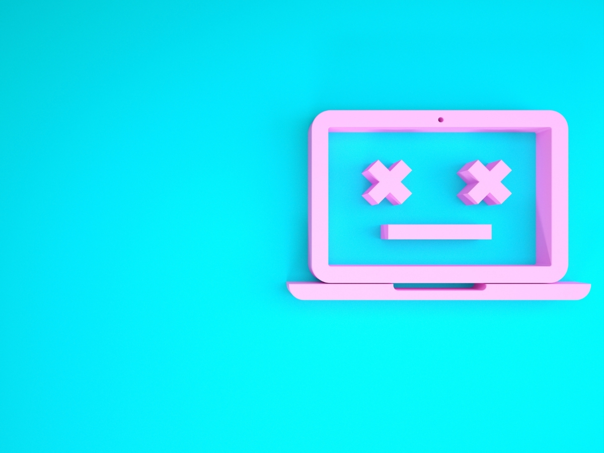A pink dead laptop computer icon