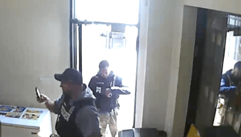 Baltimore City Police officers raid the store of Sean Weston