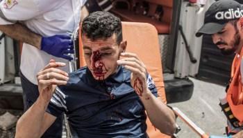 Palestine paramedics transport an injured protester