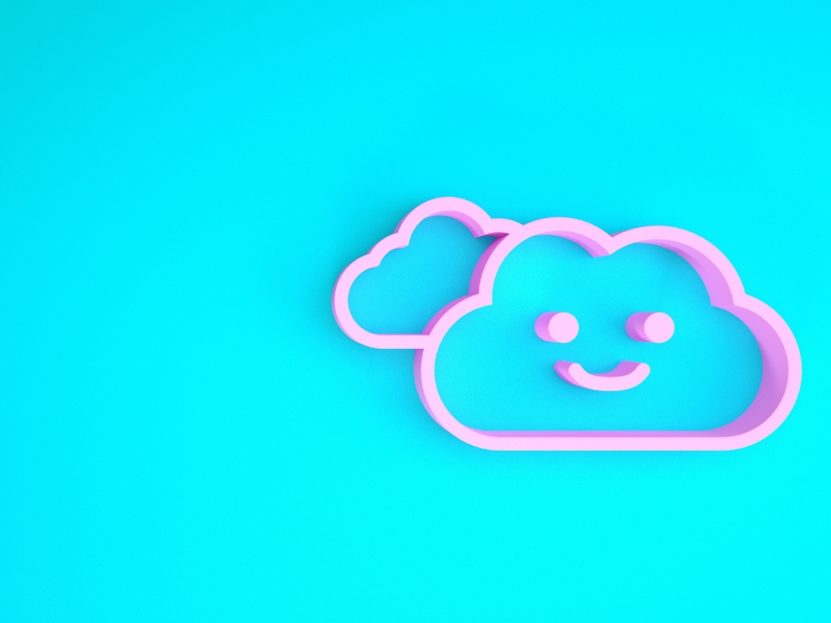 A smiling pink cloud on a blue background