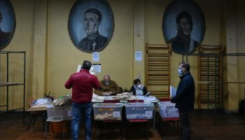 Members of the electoral table count votes at a polling station in Santiago, Chile