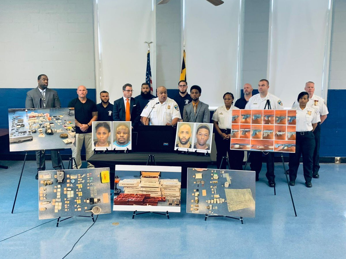 Baltimore Police Commissioner Michael Harrison, Baltimore Mayor Brandon Scott, and other officials at a news conference held July 7, 2021 to announce a series of arrests. Photo courtesy Scott's Twitter account @mayorbmscott.