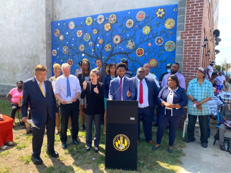 Baltimore Mayor Brandon Scott, center, and local lawmakers at the Rose Street Community Center in Baltimore, Md., at an event to mark the release of Scott's Baltimore City Comprehensive Violence Prevention Plan.