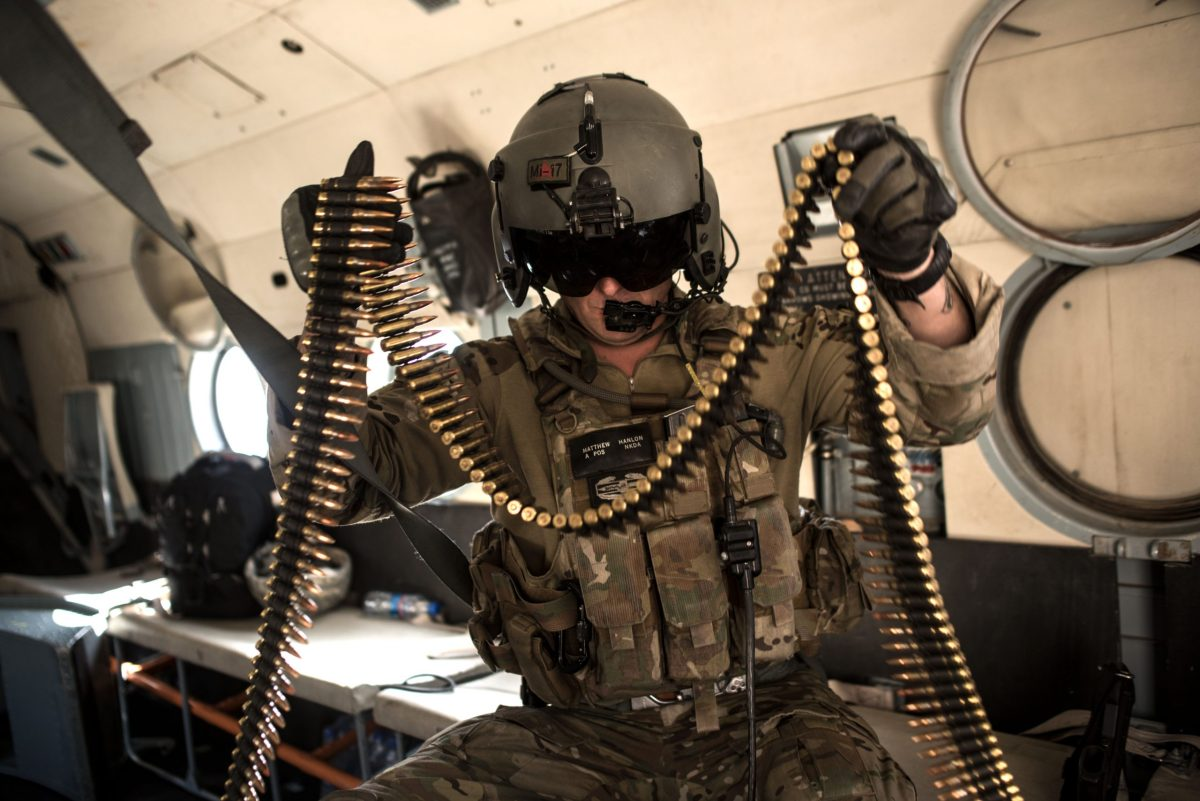 A United States Army advisor for the Afghan Air Force 777 Special Mission Wing reloads ammunition during a training mission on September 13, 2017 outside of Kabul, Afghanistan