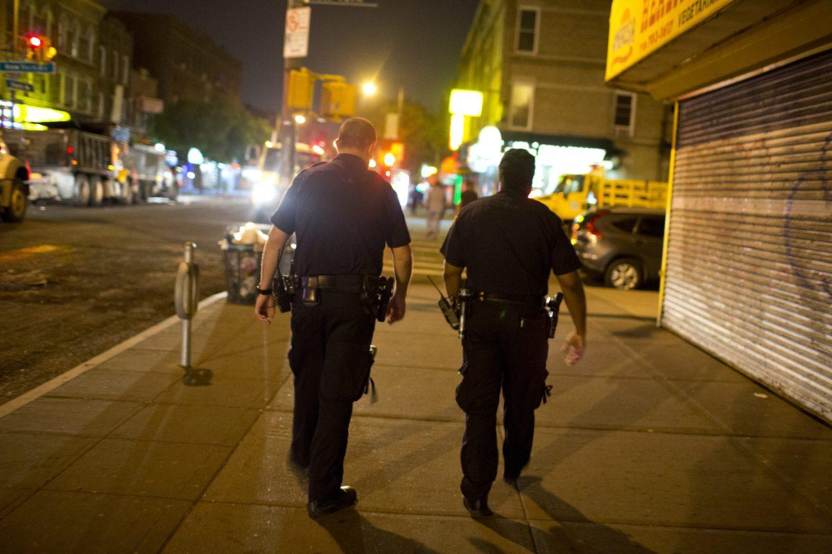 Officers from the 67th Precinct in East Flatbush, Brooklyn patrol the neighborhood