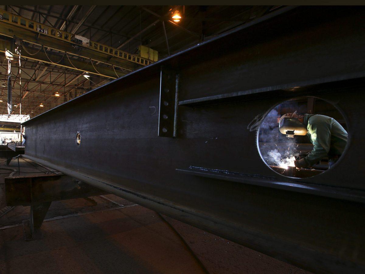 Welder Marvin Chapman welds clips onto a steel column