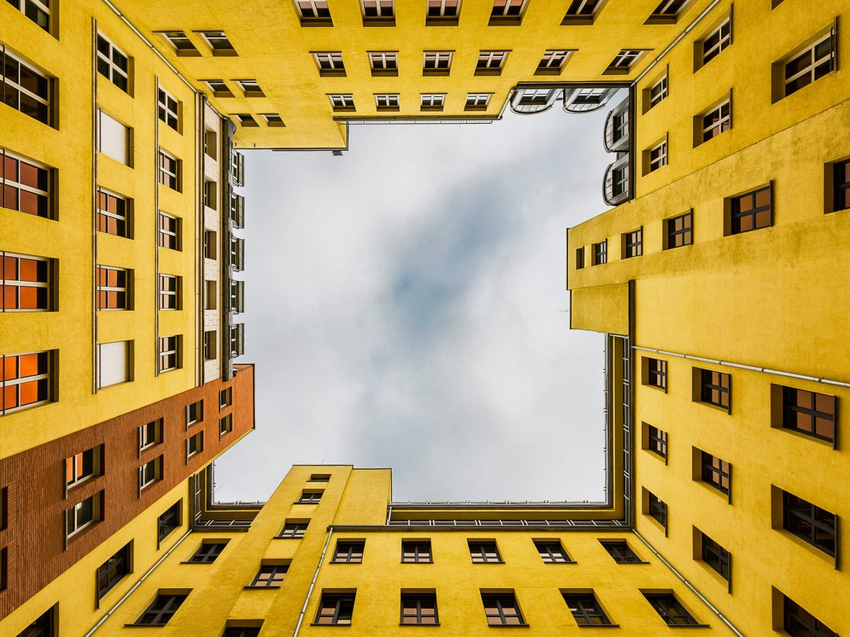 Photo taken looking up toward the sky from an inner courtyards of the Quartier Schützenstraße in Berlin, Germany