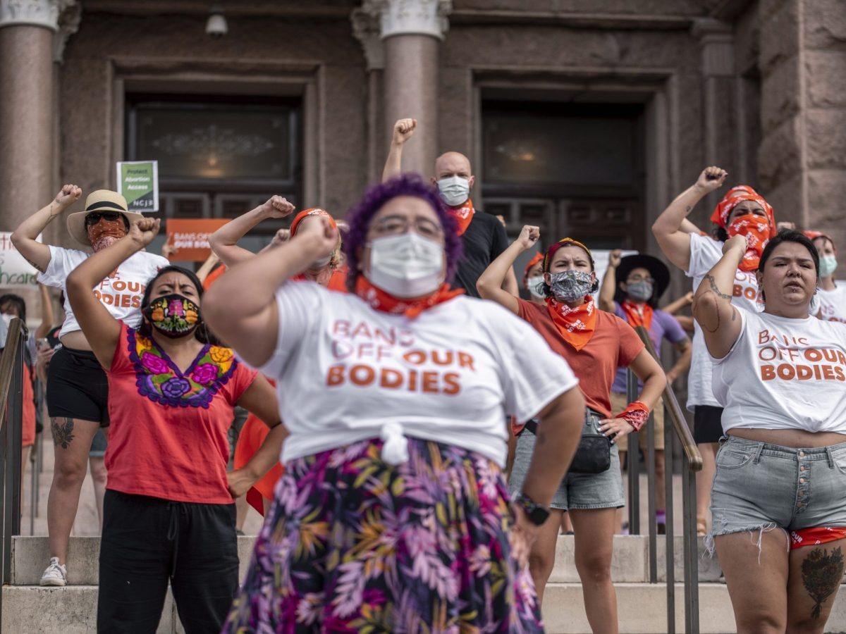 Pro-choice protesters perform outside the Texas State Capitol