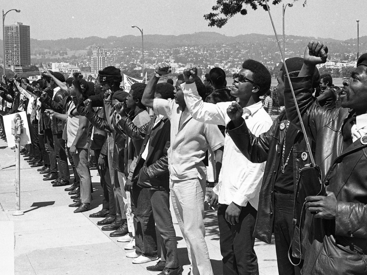 Demonstrators rally outside the Alameda County Courthouse in Oakland, California, during the Huey Newton murder trial on July 17, 1968