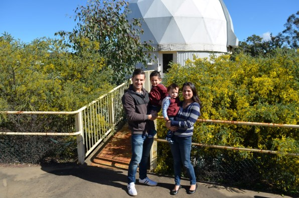 Family photo outside the Skywatch observatory