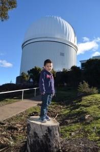 Levi posing next to Siding Spring Observatory