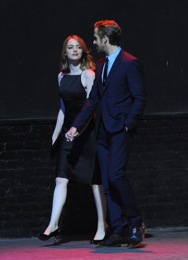 actress-emma-stone-is-smoking-hot-in-a-black-dress-as-she-continues-to-film-la-la-land-in-hollywood-with-co-star-ryan