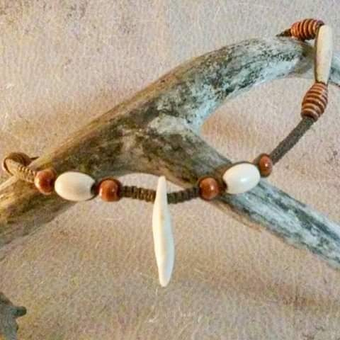 Coyote Fang and Antiqued Bone Hairpipe with wood honeyhive beads rockin' the light brown hemp.
