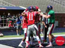 Markell Pack and Red team celebrate Grove Bowl TD