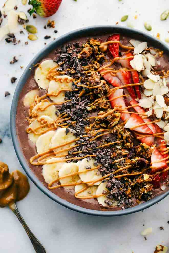 The Peanut Butter Chocolate acai bowl drizzled with peanut butter topping.
