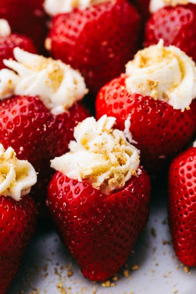 Close up on cheesecake stuffed strawberries.