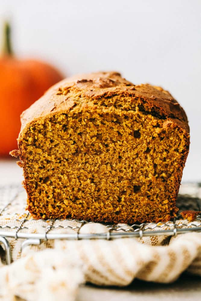 Perfectly spiced moist and tender pumpkin bread on a wire rack.