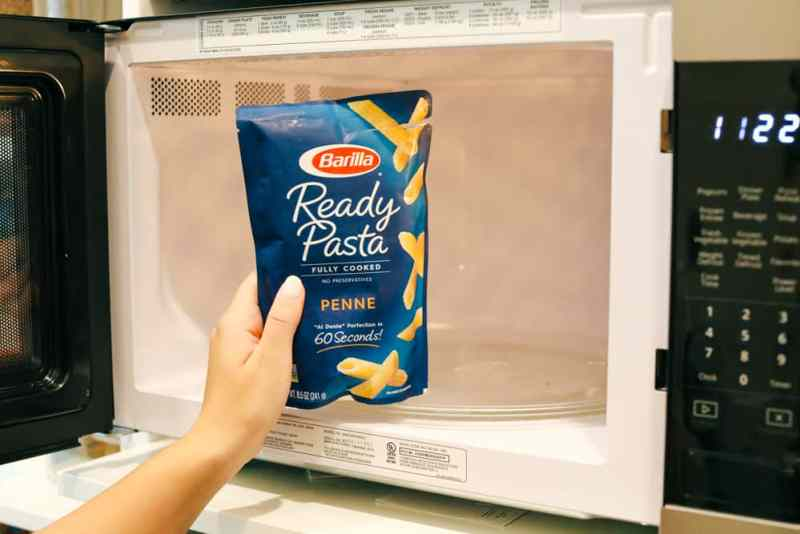 Barilla Ready Pasta being put in the microwave.