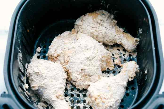 Air fryer full of ready to cook fried chicken.