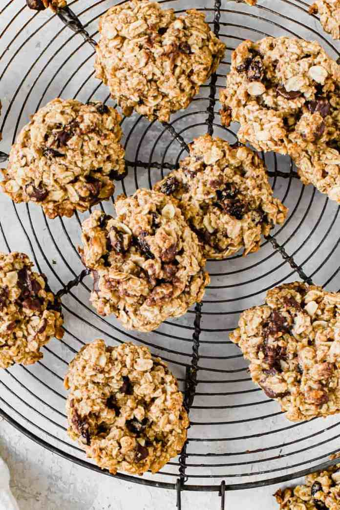 Oatmeal cookies on a round wire rack.
