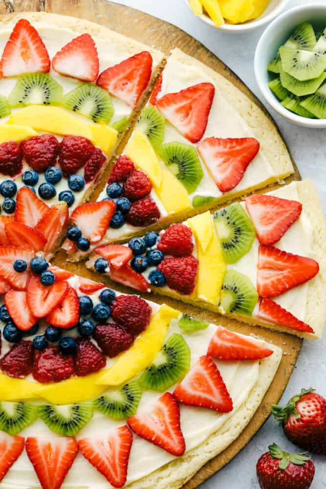 Fruit pizza cut into slices.
