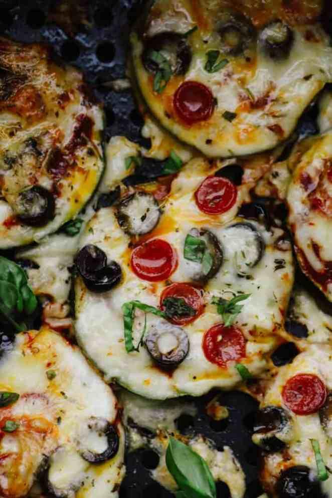Savory zucchini bites garnished with fresh basil.