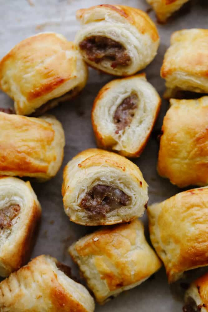 A sausage roll on a baking sheet.