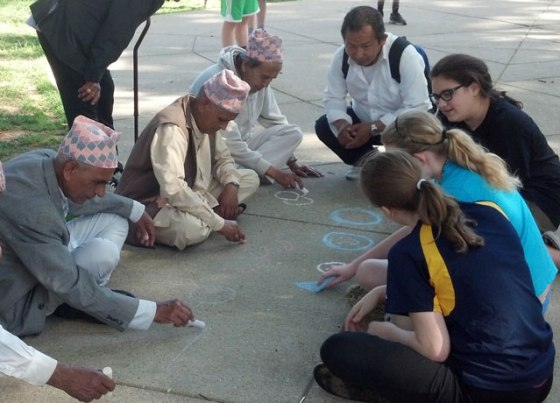 Refugees from Nepal, Bhutan, Cuba and Burma drew with chalk on a sidewalk at Willow Park in the Highlands June 4 with students from St. Francis of Assisi School. About 60 refugees aided by Catholic Charities and Kentucky Refugee Ministries attended the annual picnic. About 20 volunteers from St. Francis of Assisi also attended. (Photo Special to The Record)