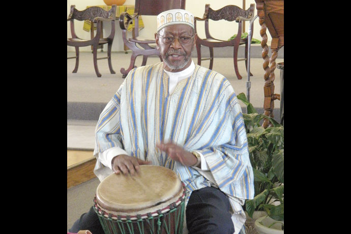 Brother Shahid Abdullah Shabazz accompanied a choir on the African drum during a Mass Aug. 23 to celebrate St. Augustine Church's 145th anniversary. Record Photo by Ruby Thomas