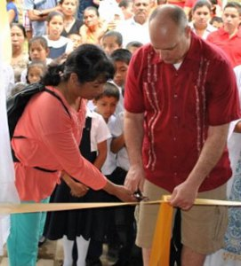 Joy and Wesley Martin  cut the ribbons during a ceremony to inaugurate John Paul II Church.