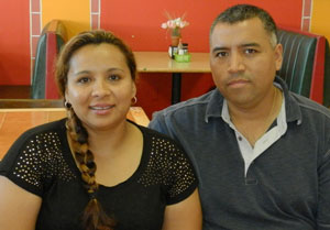 Griselda and Oscar Saucedo, photographed in their bakery La Espiga in Shelbyville, Ky., have been members of Annunciation Church for 20 years. Record Photo by Ruby Thomas