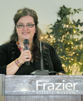 """Marissa Castellanos, who manages the human trafficking program for Catholic Charities of Louisville, addressed 300 people who attended the """"Human Trafficking Summit: A Look at Modern-Day Slavery in Kentucky"""" at the Frazier History Museum Oct. 20. (Record Photo by Jessica Able)"""