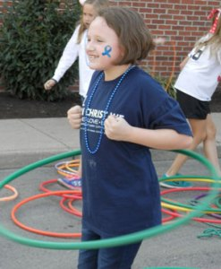 A student dances the hula hoop during a carnival event at St. Margaret Mary.