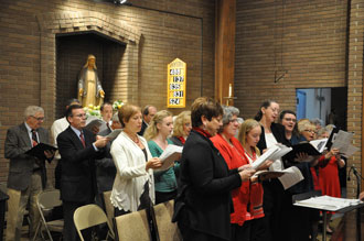 Former and current members of St. Barnabas's choir came together for a final time to sing at the parish' closing liturgy Nov. 22.