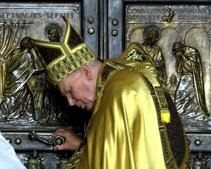 St. John Paul II closed the Holy Door in St. Peter's Basilica at the Vatican in this Jan. 6, 2001, file photo. Pope Francis will open the Holy Door Dec. 8 during a Mass marking the opening of the Holy Year of Mercy. (CNS File Photo)