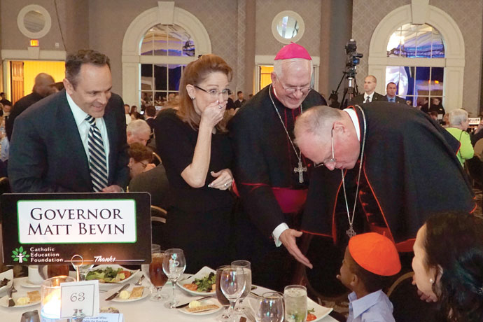 Cardinal Timothy M. Dolan, Archbishop of New York, met Kentucky Gov. Matt Bevin and his family during the Catholic Education Foundation's Salute to Catholic School Alumni dinner March 16. The cardinal greeted the governor, who took office in December, and his wife Glenna and spent time interacting with each of their children, even placing his zucchetto or skullcap on one of the young boys. (Record Photo by Marnie McAllister)